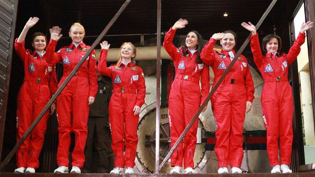 Six female Russian astronauts wave before boarding a capsule for an experiment conducted at Moscowu2019s Institute of Biomedical Problems, Oct  28, 2015. (Facebook Photo)