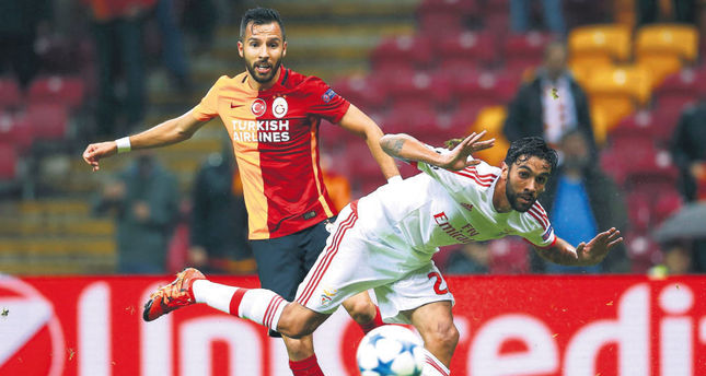 Galatasaray's Yasin Oztekin (L) is challenged by Benfica's Silvio during their Champions League Group C match at the Ali Sami Yen stadium in Istanbul on Oct. 21.