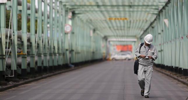 A man walks inside a factory at the Keihin industrial zone in Kawasaki, south of Tokyo.