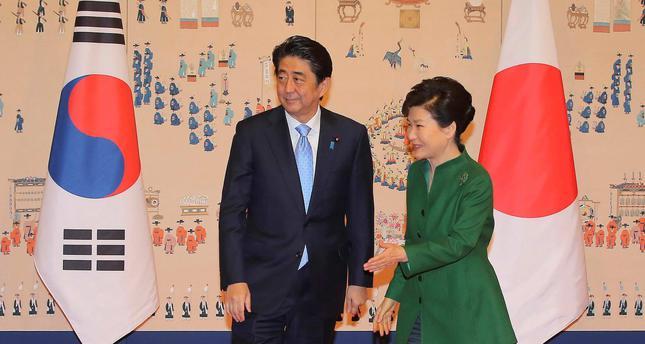 South Korean President Park Geun-hye (R) escorts Japanese Prime Minister Shinzo Abe before their meeting at the presidential Blue House in Seoul, South Korea.