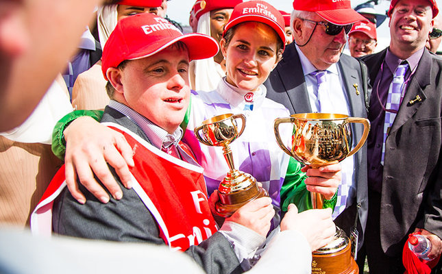 Jockey Michelle Payne of Australia (R) hugs her brother Steven after becoming the first female jockey to win a Melbourne Cup on Prince of Penzance at Flemington Racecourse on Melbourne Cup day in Melbourne on November 3, 2015. (AA Photo)