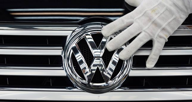 German auto giant VW said on October 28, 2015 that the global pollution-cheating scam it is currently embroiled in pushed it deeply into the red in the 3rd quarter and would hurt earnings for the whole of 2015. (AFP Photo)
