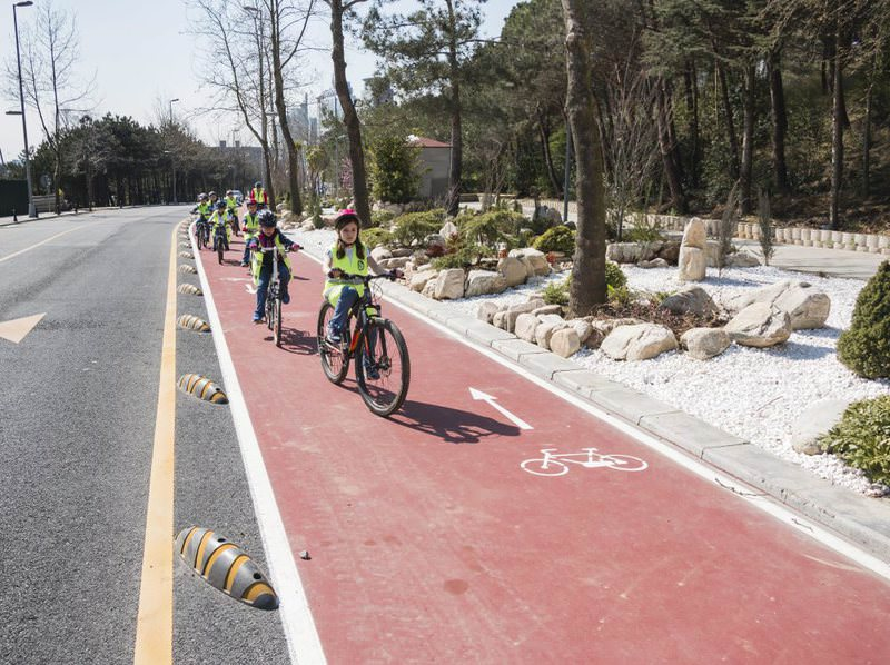 Children cycle on a bicycle lane in Istanbul. New bicycle lanes will have higher standards and more integration to mass transit hubs.