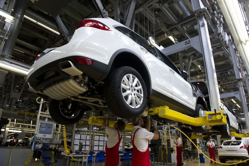 Workers assemble a Porsche Cayenne model on the production line at the plant of German luxury carmaker Porsche, a Vokswagen brand, in Leipzig, Germany.