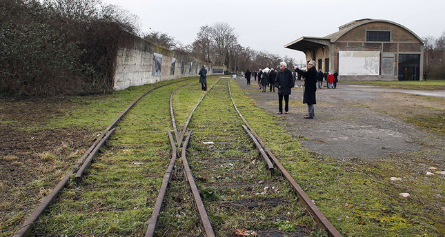 This January 27, 2015 file photo shows people as they attend the inauguration of the renovated goods shed of a former train station in Bobigny, north-east of Paris (AFP Photo)