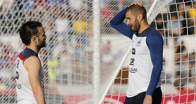 In this June 10, 2014 file photo, France's Mathieu Valbuena, left, and Karim Benzema, right, chat during a training session of the french national soccer team, at the Santa Cruz Stadium in Ribeirao Preto, Brazil (AP Photo)