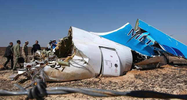 Russian Emergency Situations Minister Vladimir Puchkov (4-L) and unidentified officials near a piece of wreckage of Russian MetroJet Airbus A321 at the site of the crash in Sinai, Egypt, 01 November 2015. (EPA Photo)