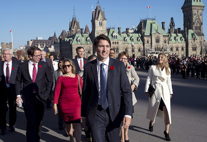 PM Trudeau and his newly sworn-in cabinet ministers arrive on Parliament Hill in Ottawa on Wednesday October 31, 2015 (AP Photo)