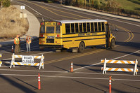 A bus passes through a roadblock leading to Umpqua Community College, Friday, Oct. 2, 2015, in Roseburg, Ore, the U.S. (AP photo)