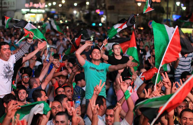 Palestinians celebrate in the West Bank city of Ramallah after they beat the Philippines in AFC Challenge Cup. (AFP Photo)