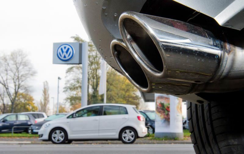 The exhaust pipe of a Skoda with a TDI diesel engine is parked in front of a Volkswagen used car dealership in Hanover, Germany.