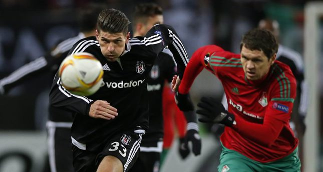 Taras Mikhalik (R) of Lokomotiv Moscow in action against Mario Gomez (L) of Beşiktaş  during the UEFA Europa League match group H at the Lokomotiv stadium in Moscow on Oct. 22.