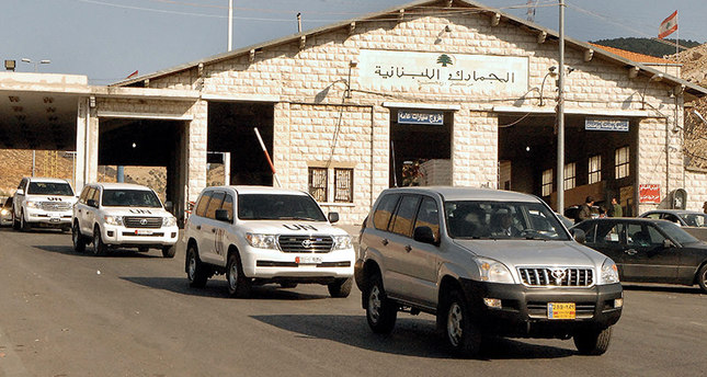 A file photo dated 30 September 2013 shows a convoy of UN vehicles carrying the UN team of inspectors investigating the alleged use of chemical weapons in Syria crossing into Lebanon from Syria (EPA Photo)
