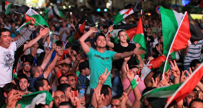 Palestinians celebrate in the West Bank city of Ramallah after they beat the Philippines in AFC Challenge Cup. AFP Photo