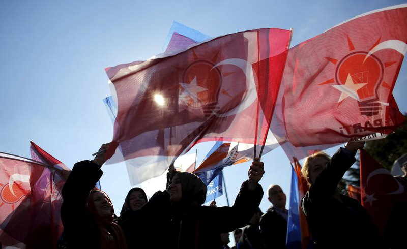 AK Party supporters wave flags as they wait for the arrival of PM Ahmet Davutou011flu in Istanbul, following their election victory.