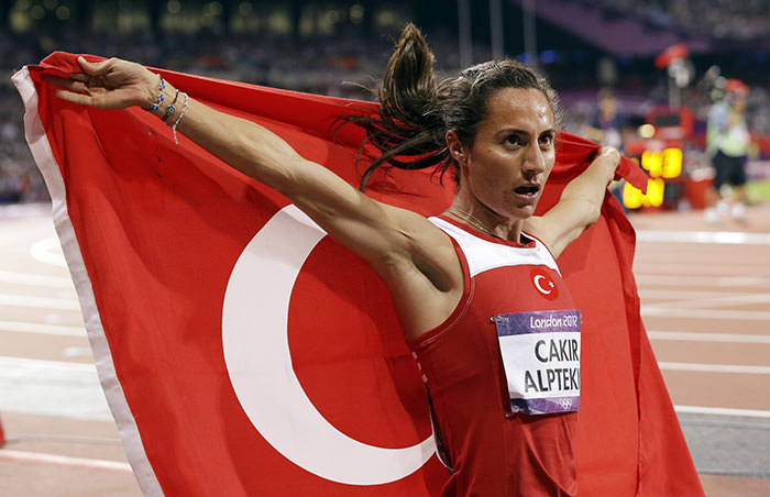 Asli Cakir Alptekin celebrates her gold medal in the women's 1500-meter during the athletics in the Olympic Stadium at the 2012 Summer Olympics, London (AP Photo)