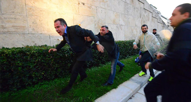 Greek MP Koumoutsakos punched by far-right activists during protest in Athens