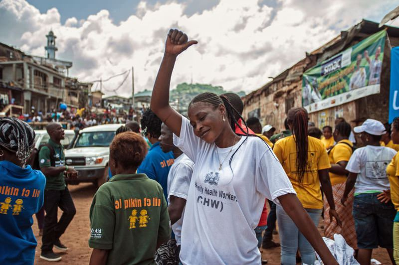 A woman celebrates with others as the country is declared Ebola free in the city of Freetown, Sierra Leone, Saturday, Nov. 7, 2015. (AP Photo)