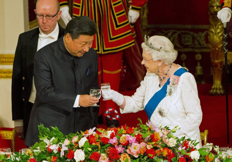 Britain's Queen Elizabeth II hosts a state banquet for Chinese President Xi Jinping at Buckingham Palace in London on Oct. 20 the first official day of Xi's state visit.
