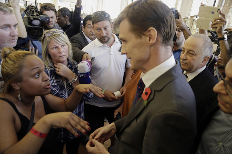 The British Ambassador to Egypt, John Casson, talks to British tourists after the announcement that there would not be any more flights to evacuate tourists from Egypt, Nov. 6, 2015. (AP Photo)