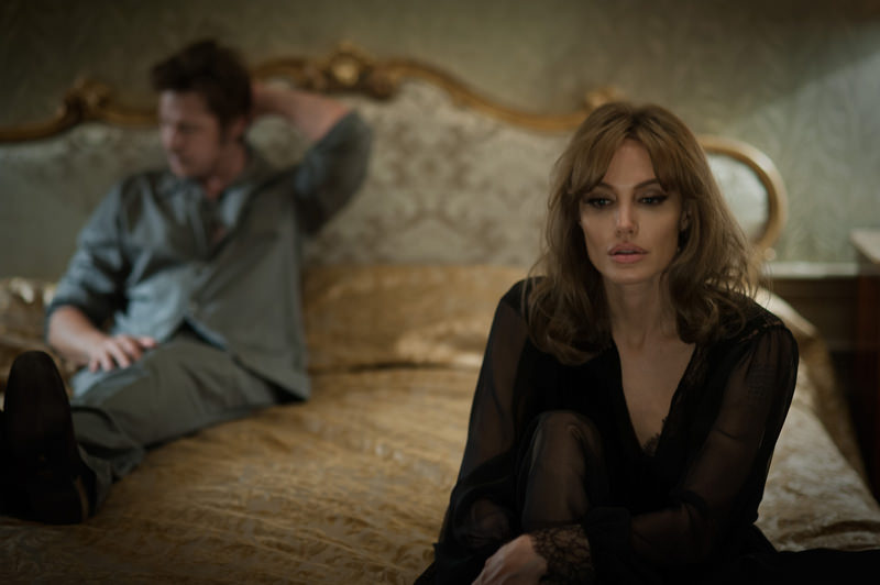 This photo provided by Universal Pictures shows, Brad Pitt, left, as Roland and Angelina Jolie Pitt as Vanessa in a scene from the film ,By the Sea,, directed by Jolie Pitt. (AP Photo)