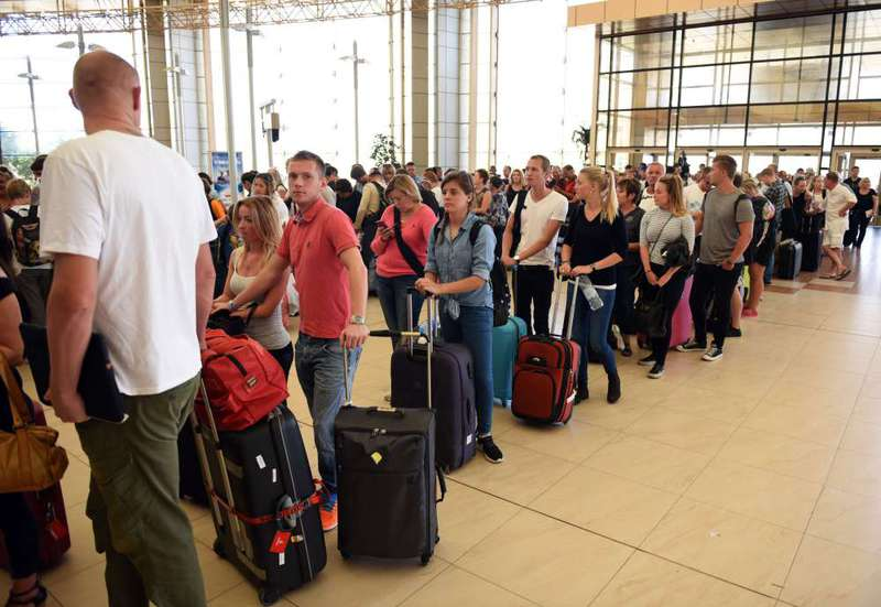 Tourists queue up at check-in counters at the airport of Egypt's Red Sea resort of Sharm El-Sheikh