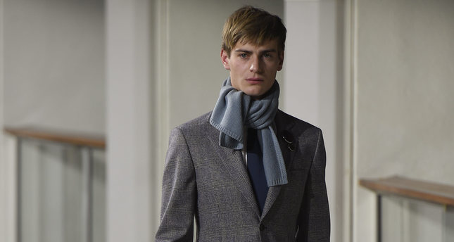 Hermes's accessories has created a colorful effect on classic suits.