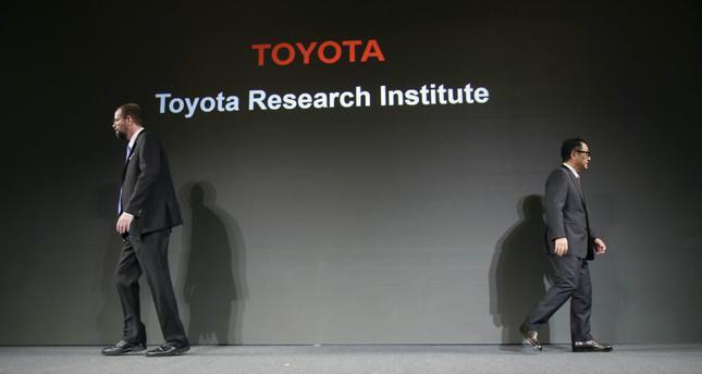Akio Toyoda (R), president of Toyota Motor Corp. and Gill Pratt, Executive Technical Advisor of Toyota Motor Corp.