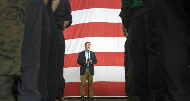 U.S. Secretary of Defense Ashton Carter speaks with U.S. service members aboard the USS Theodore Roosevelt on a visit to the aircraft carrier in the South China Sea.