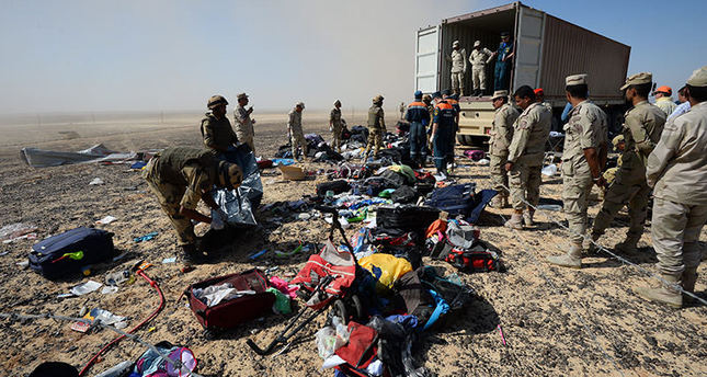 In this Monday, Nov. 2, 2015 file photo provided by Russian Ministry for Emergency Situations, Egyptian soldiers collect personal belongings of plane crash victims (AP photo)