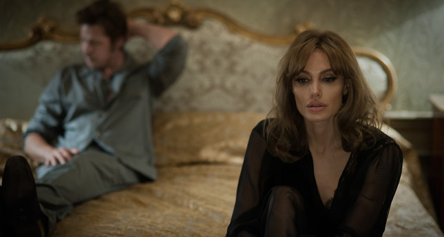 This photo provided by Universal Pictures shows, Brad Pitt, left, as Roland and Angelina Jolie Pitt as Vanessa in a scene from the film By the Sea, directed by Jolie Pitt. (AP Photo)