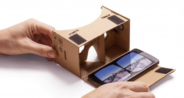 Photo shows Alphabet Inc's Cardboard device, a handheld gadget made from the standard box material that creates a VR viewing experience.
