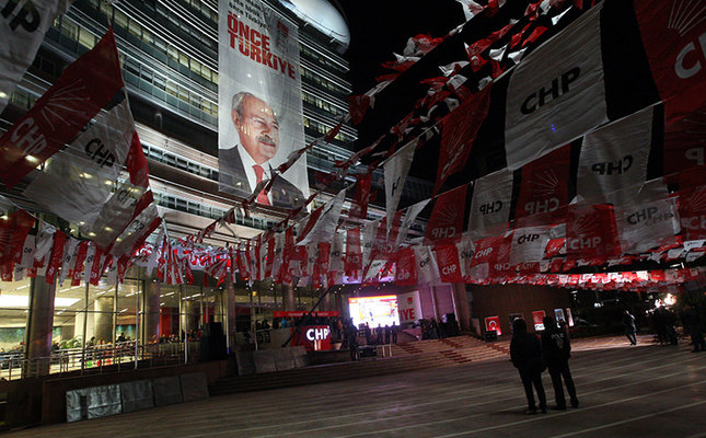 A giant banner of Chairman Kılıçdaroğlu hung over CHP headquarters in Ankara looks up to the empty area decorated for a possible election success on the night elections, November 1, 2015. (Photo: Sabah / Ali Ekeyılmaz)
