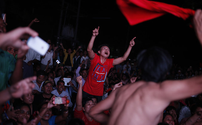 Supporters of oppositional leader Aung San Su Kyi's National League for Democracy (NLD) party celebrate in Mandalay, Myanmar, Sunday Nov 8, 2015. (AP Photo)
