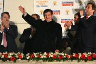 Prime Minister Ahmet Davutoğlu waves to supporters from the balcony of AK Party headquarters in Ankara, which has become a tradition after the party's successive wins.
