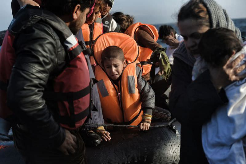 Refugees arrive on the Greek island of Lesbos after crossing the Aegean Sea from Turkey.