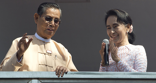 Leader of Myanmar's National League for Democracy party, Aung San Suu Kyi, delivers a speech with party patron Tin Oo from a balcony of her party's headquarters in Yangon, Myanmar (AP Photo)