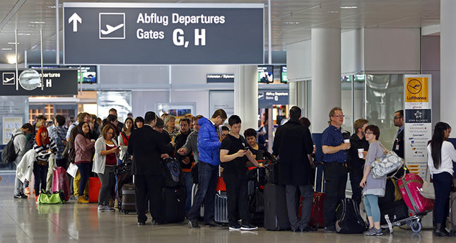 Passengers wait for information at a Lufthansa counter at the airport in Munich, Germany, Monday, Nov. 9, 2015 AP photo
