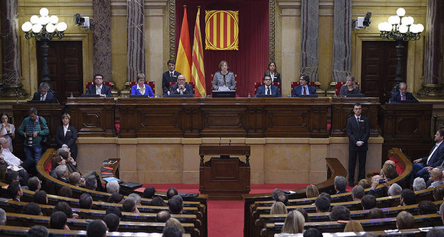 Carme Forcadell (C) delivers her first speech as Parliament's new president during the Catalan regional Parliament's constitutive session on October 26, 2015 (AFP Photo)