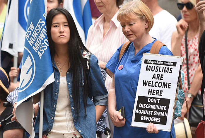 A demonstrator (Left) representing the NSW Nurses and Midwives' Association at a rally in support of refugees and asylum seekers in Sydney (AFP Photo)