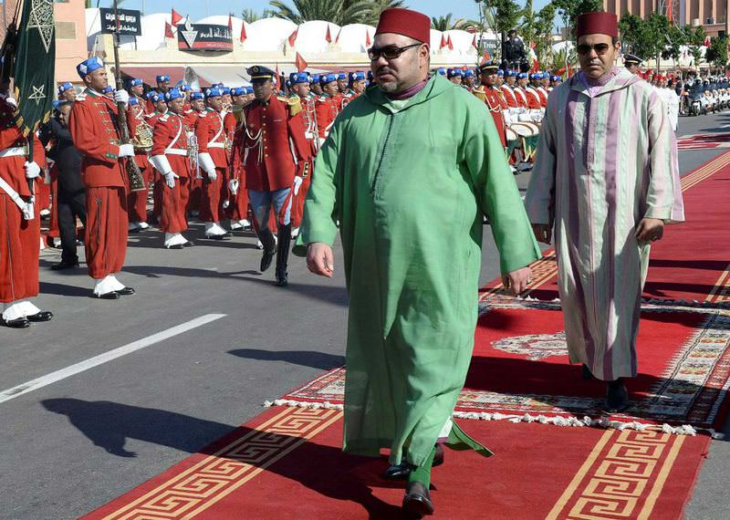 Moroccan King Mohammed VI (L) and his brother Prince Moulay Rachid arrive at a ceremony in Laayoun in the region of the Western Sahara.