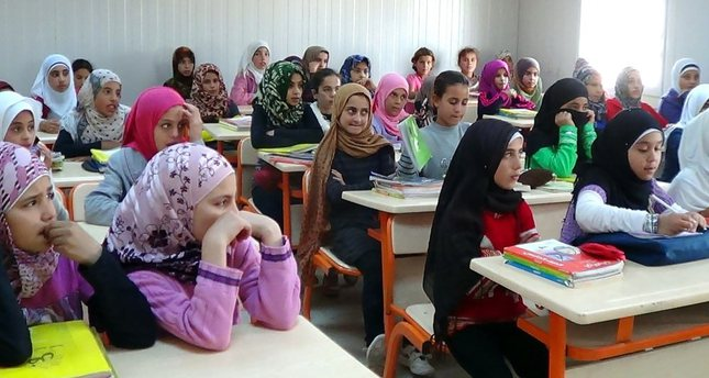 Syrian students at a school set up at a refugee camp near Şanlıurfa. Most tent camps in the country house educational facilities.