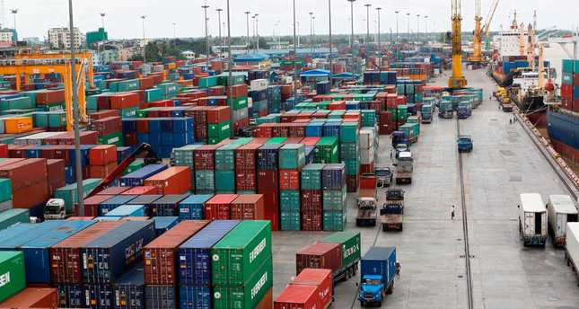 OECD warns of global trade slowdown, trims growth outlook