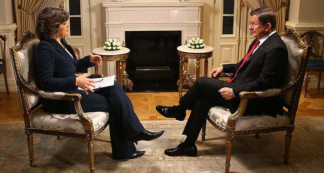 Davutoğlu R answered the questions of CNN's Amanpour L