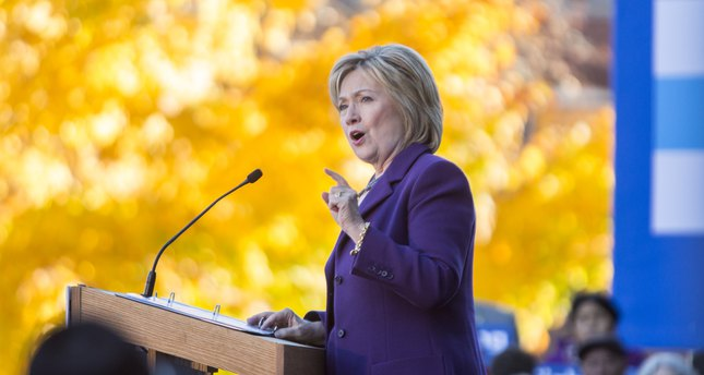 Democratic presidential candidate Hillary Clinton speaks on stage during a rally after filing paperwork for the New Hampshire primary at the State House on November 9, 2015. (AFP Photo)
