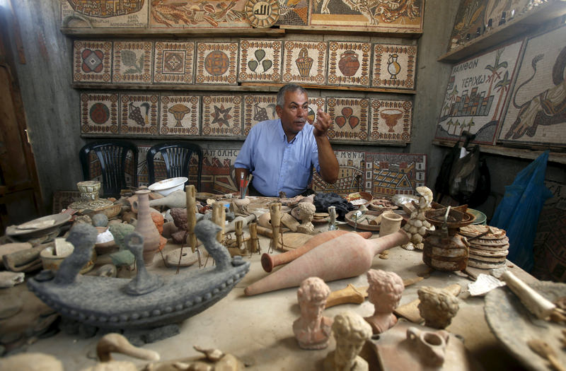 Abed in his workshop amid his finds, restorations and reproductions of pieces that go back millenia.