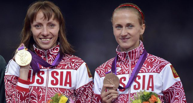 Gold medal winner Mariya Savinova of Russia (L) and bronze medalist Ekaterina Poistogova of Russia (R) during the medal ceremony of the Women's 800m at the London 2012 Olympic Games Athletics, Track and Field events at the Olympic Stadium, London.