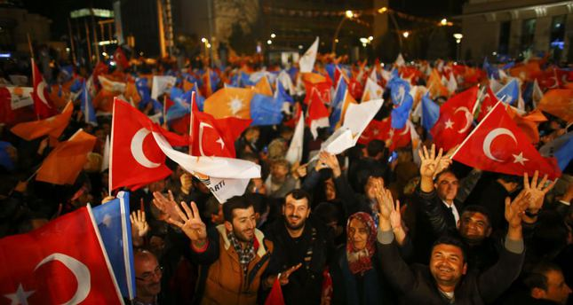 People wave flags outside the AK Party headquarters in Ankara after the party's victory in the Nov. 1 elections.