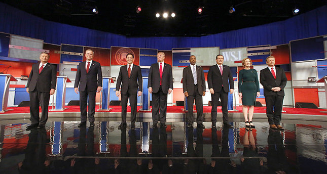Republican presidential candidates John Kasich, Jeb Bush, Marco Rubio, Donald Trump, Ben Carson, Ted Cruz, Carly Fiorina and Rand Paul take the stage before the presidential debate at the Milwaukee Theatre, Tuesday, Nov. 10, 2015. (AP Photo)