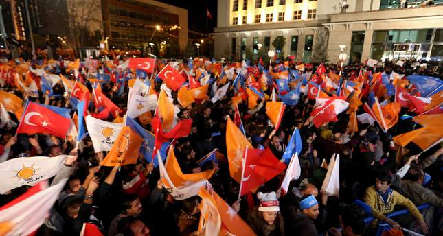 Supporters of Justice and Development Party (AKP) celebrate after hearing the early results of the general elections in front of the party's headquarters in Ankara, Turkey, 01 November 2015. (EPA Photo)